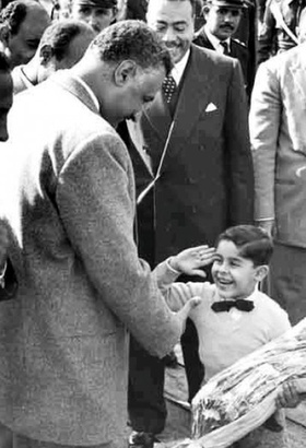 Sisi as a child saluting Nasser, 1960. Screenshot by the author, image taken from http://www.egyptiansnews.com/News2-8158.html, provenance unknown. 'In the photo, Al Sisi is just a little boy of maybe 4 or 5 years old, he is saluting Jamal Abdel Nasser and getting ready to hand him a bouquet of flowers during celebration of the Anniversary of July 23rd revolution.' Sami Mubayed, 'The Ghost of Gamal Abdul Nasser,' The Huffington Post, 30 July, 2013: http://www.huffingtonpost.com/sami-moubayed/the-ghost-of-gamal-abdul-_b_3667639.html