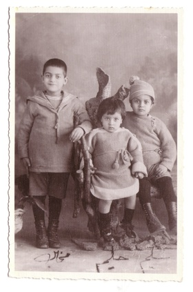 Michael, Halim (center), Selim as babies.
