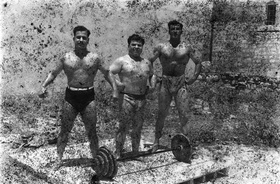 Akram Zaatari, Bodybuilders, Printed From A Damaged Negative Showing From Left To Right: Hassan El Aakkad, Munir El Dada And Mahmoud El Dimassy In Saida, 1948, 2011. Inkjet print. 180 x 145 cm. 70 7/8 x 57 1/8 in.