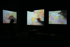 Bouchra Khalili, The Mapping Journey Project, 2008-2011, video installation, 8 single channels, installation view, 10th Sharjah Biennale, 2011. Courtesy of the artist. Photo by Haupt & Binder.