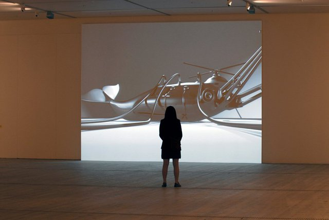 Mona Marzouk, The Bride Stripped Bare by Her Energy's' Evil, 2006, two large scale wall paintings (10 m each + acrylic colors), audio elements and a projected short 3D animated film,  2 min. 44 sec. Installation view at BALTIC Centre for Contemporary Art, Gateshead, UK.