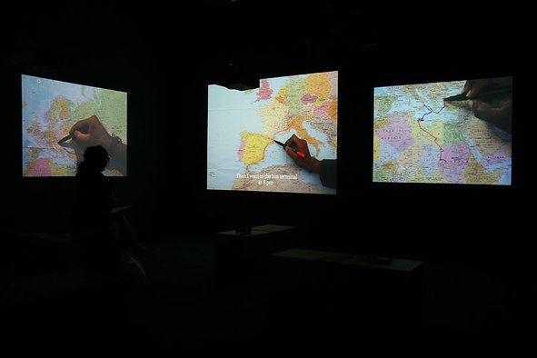 <div><div><div><div><div>Bouchra Khalili</div><div><em>The Mapping Journey Project</em>, 2008-2011</div><div>Video installation, 8 single channels</div><div>Installation view, 10th Sharjah Biennale, 2011</div><div>Courtesy of the artist. Photo by Haupt & Binder.</div></div></div></div></div>