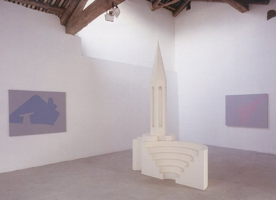 <p>Mona Marzouk, <em>Reconfigured Monuments<em>, 2001, sculpture: painted wood, 210 x 150 x 270 cm and three paintings: acrylic on canvas, 140 x 110 cm. Installation view, Marco Noire Contemporary Arts Gallery, Turin, Italy, 2002.</em></em></p><p>Courtesy: The Modern Art Gallery (GAM), Turin, Italy.</p>&nbsp;