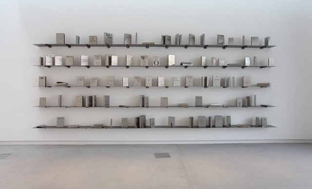 <p>Shilpa Gupta</p><p><em>Someone Else – A library of 100 books written anonymously or under pseudonyms</em>, 2011</p><p>Stainless steel and mild steel, seventy-five books courtesy of Kiran Nadar Museum, New Delhi, twenty-five books produced by Sharjah Art Foundation</p><p>Image courtesy of Sharjah Art Foundation</p>