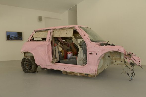 <p>Sarah Abu Abdallah</p><p><em>Saudi Automobile</em>, 2011</p><p>Colour video LCD with sound, scrap car and pink paint</p><p>Courtesy of the artist and Alāan Artspace, Riyadh</p><p>Image courtesy of Sharjah Art Foundation</p>