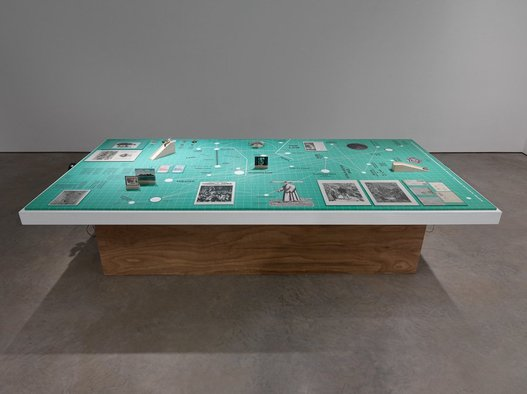 <p>Rana Hamadeh</p><p><em>The Big Board </em></p><p><em>or …'And before it falls, it is only reasonable to enjoy life a little.'</em>, 2013</p><p>Performance and stage set with various objects</p><p>Courtesy the artist and Lisson Gallery</p>