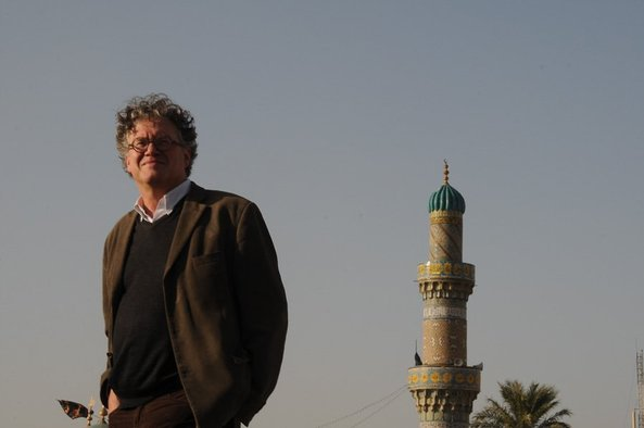 <p>Curator Jonathan Watkins on the rooftop of the historic Mustansiriya School building in old Baghdad</p><p>Courtesy RUYA Foundation</p>