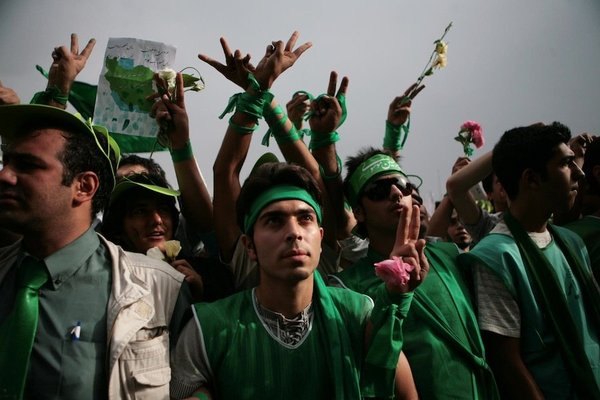 <p>Newsha Tavakolian, 2011</p><p>Photograph</p><p>Courtesy of the artist</p><p> </p><p>10: Supporters of Mir-Hossein Mousavi, the main challenger of incumbent President Ahmadinejad, during a rally in which they formed a human chain along Tehran's main artery, the 12-mile-long Vali-e Asr street. They dress in green as this is chosen as the signature colour for Mousavi.</p>