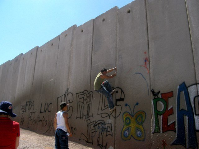 Members of G-Town climbing the Separation Wall at Shu'afat Camp, 2008 Photograph courtesy of Dana Hercbergs