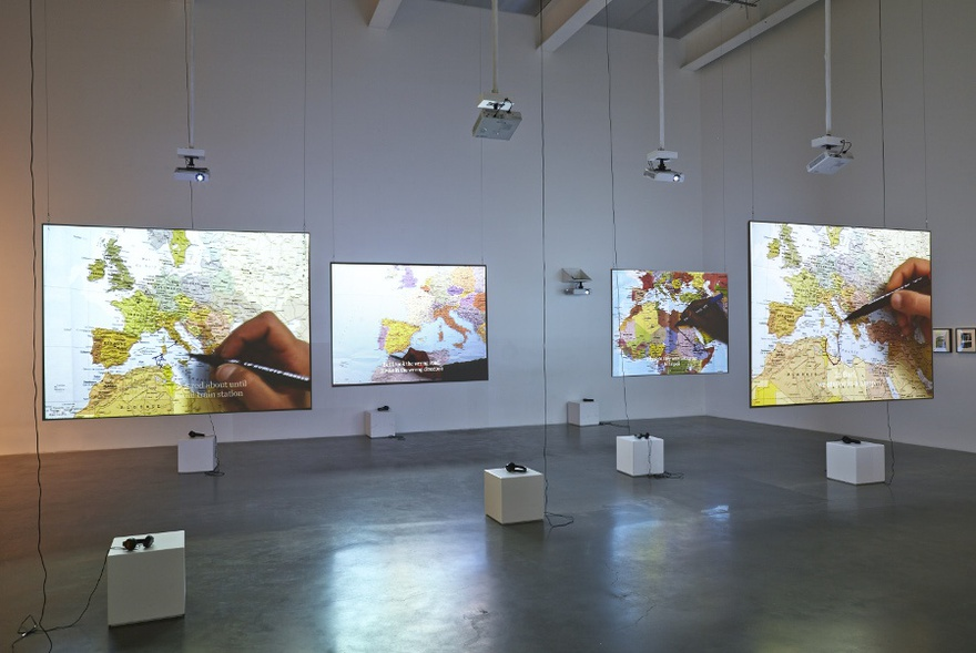 Bouchra Khalili, The Mapping Journey Project, Video installation. 8 single channels, 2008-2011. View of the installation at Here & Elsewhere, The New Museum, New York, July 2014.