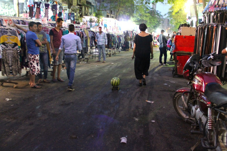 Heba Amin, Walking the Watermelon in Cairo, public performance.