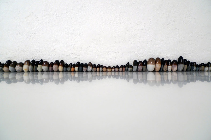 Nida Sinnokrot, Rubber-Coated Rocks (Horizon No. 2), 2009, (detail), stone, rubber, 600 cm.