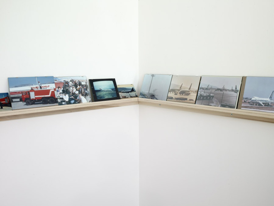 Vangelis Vlahos, Aircrafts on Ground, 2009-2010. 57 photographs (variable dimensions) on a wall mounted shelf (length 12 m). Installation view at Serralves Museum of Contemporary Art, Porto, 2010.