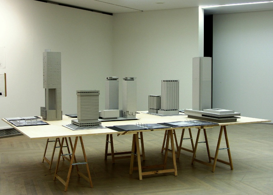 Vangelis Vlahos, Buildings like texts are socially constructed, 2004. 5 models, 7 dossiers, table (360 x 220 x 74cm). Installation view at Manifesta 5, San Sebastian, 2004.