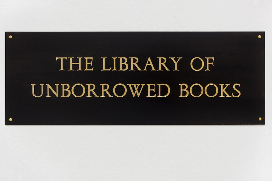 Meriç Algun Ringborg, The Library of Unborrowed Books, 2012. Site-specific installation with books, shelves, brass sign, two contracts. Section I: Stockholms Stadsbibliotek (Stockholm Public Library), 2012 at Konstakademien, Stockholm.