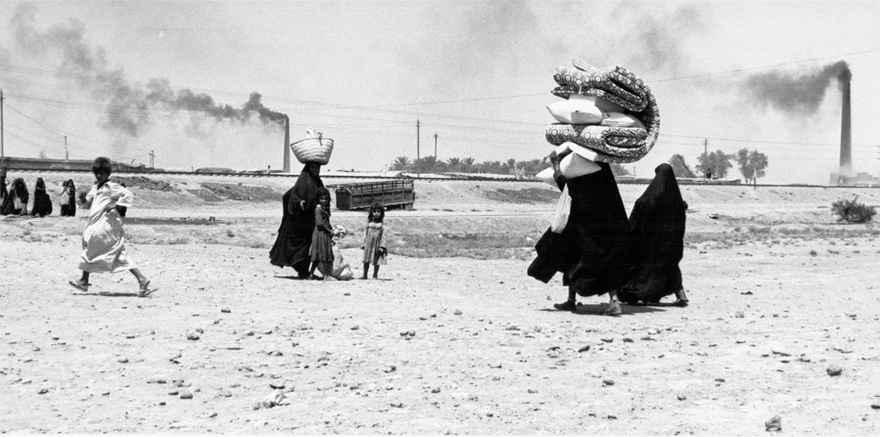 Photograph from the Chadirji collection showing women and children near a brick factory, outskirts of Baghdad.