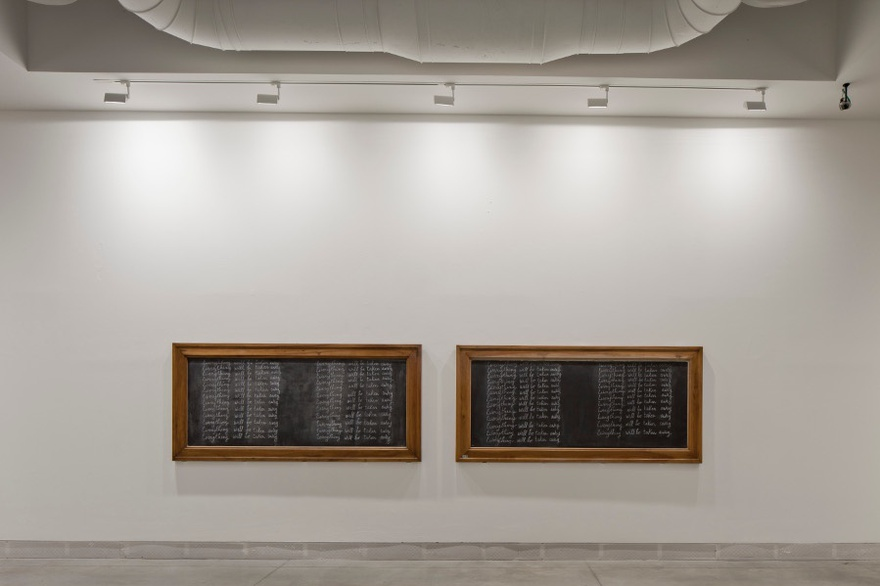 Adrian Piper, Everything 21, 2010-2013. Four boards in vintage picture frames with lacquered wood, each mounted on a wall at eye level, oriented horizontally and covered with a single phrase handwritten in cursive, in white chalk and repeated 25 times. 120 x 250 cm each. 56th International Art Exhibition - la Biennale di Venezia, All the World's Futures.