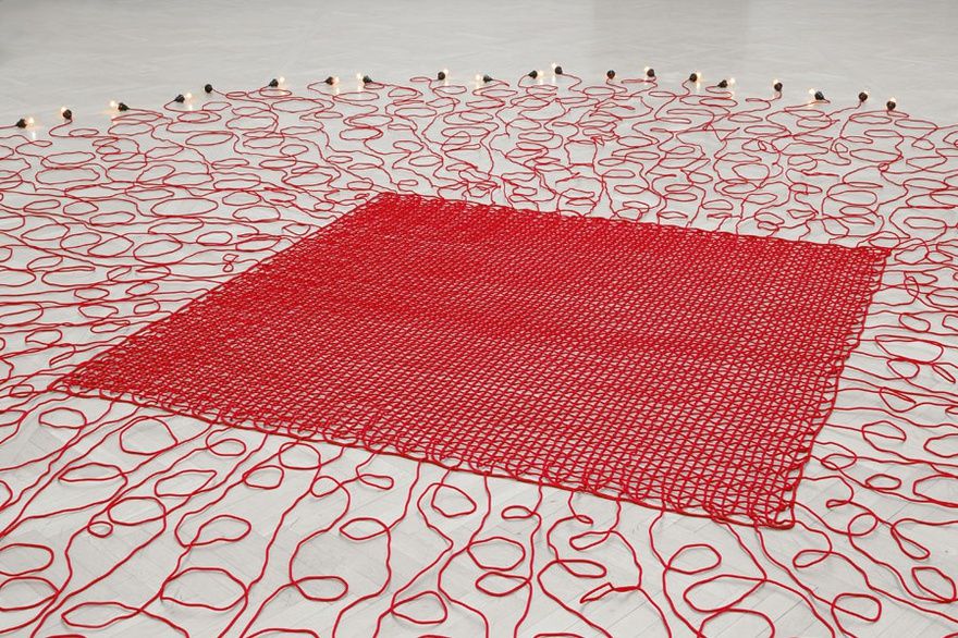 Mona Hatoum, Undercurrent (red), 2008. Electrical wires covered in fabric, with light bulbs and dimmer switch, variable dimensions.